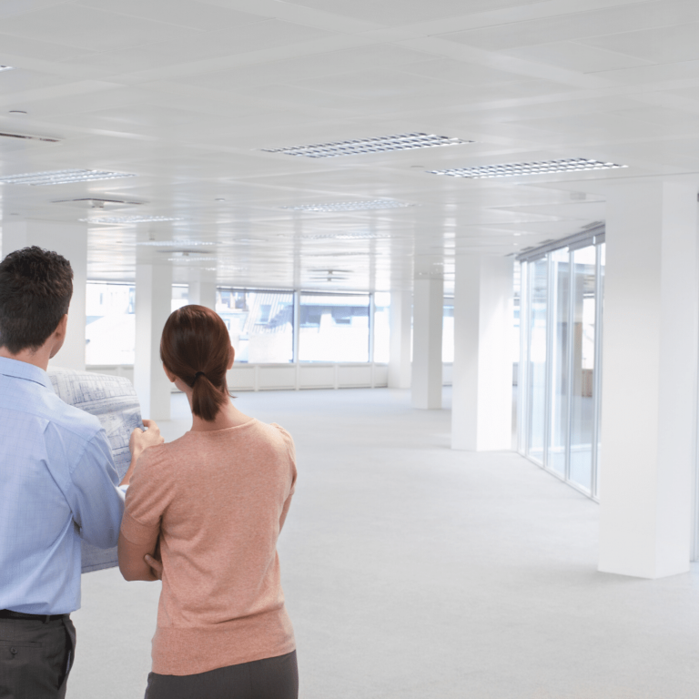 Office workers looking at new office space