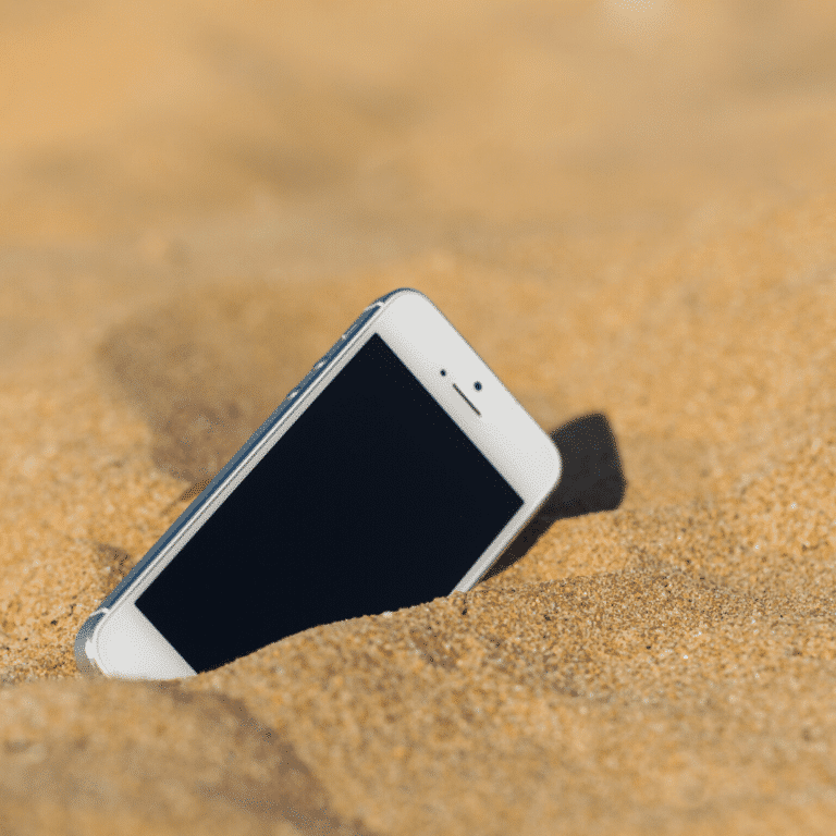 Phone buried in the sand