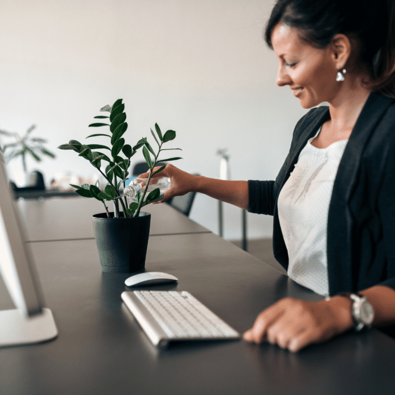 woman watering an office plant